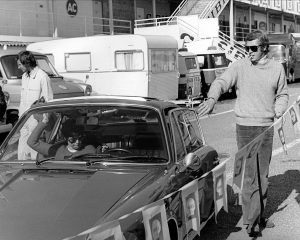 Steve McQueen getting in the car.