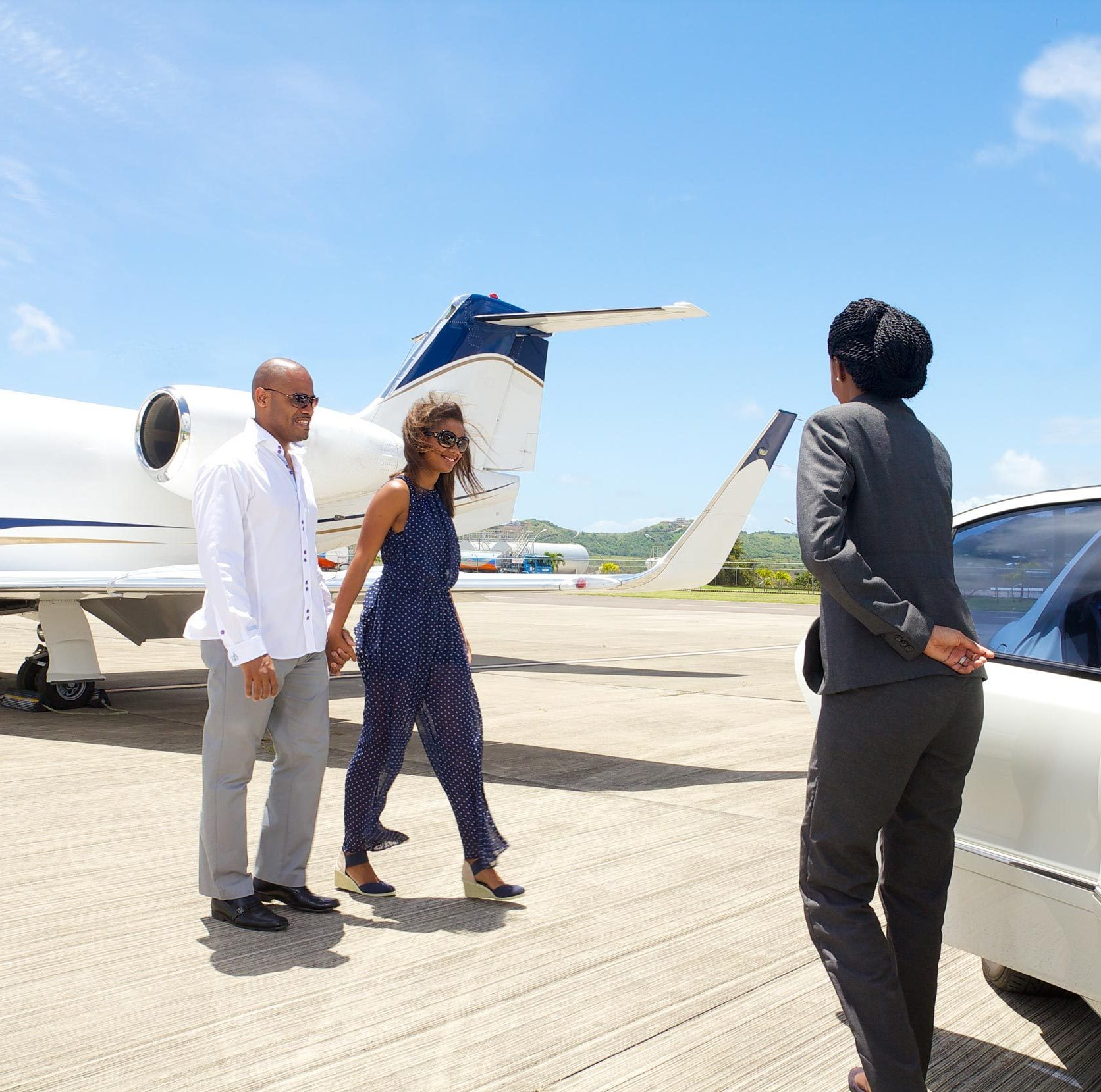 A YU Lounge attendant is picking up guests at luxury destination St. Kitts